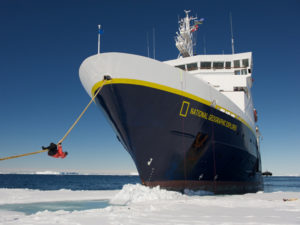 The National Geographic Explorer sails up to fast ice in the Weddell Sea, guests climb on line